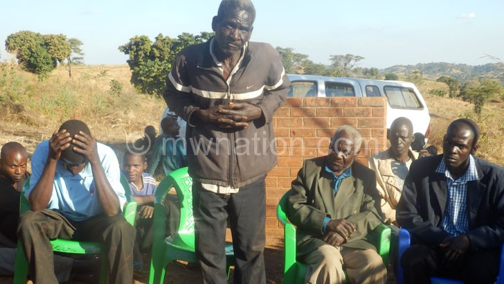 Village head Chatire empties his chest during the meeting