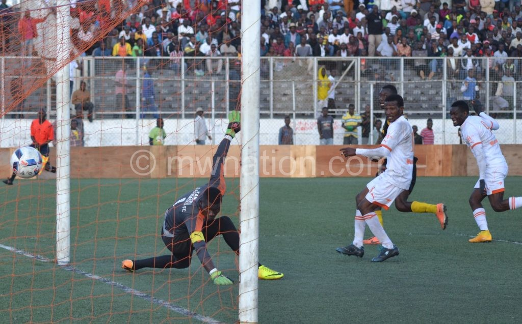 Helpless: KB goalkeeper Nthala watches as the ball zooms past him from Wadabwa's header
