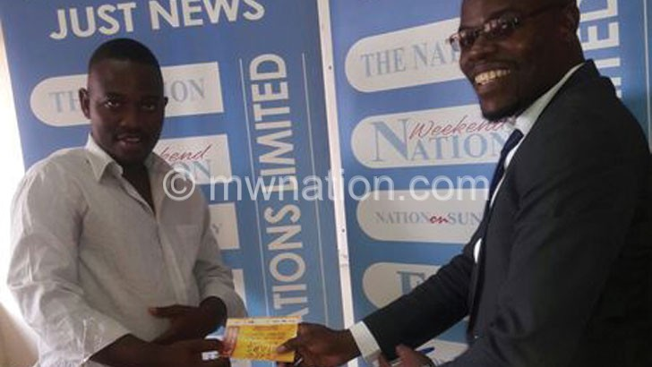 Bomba (L) receiving his ticket from Kazembe