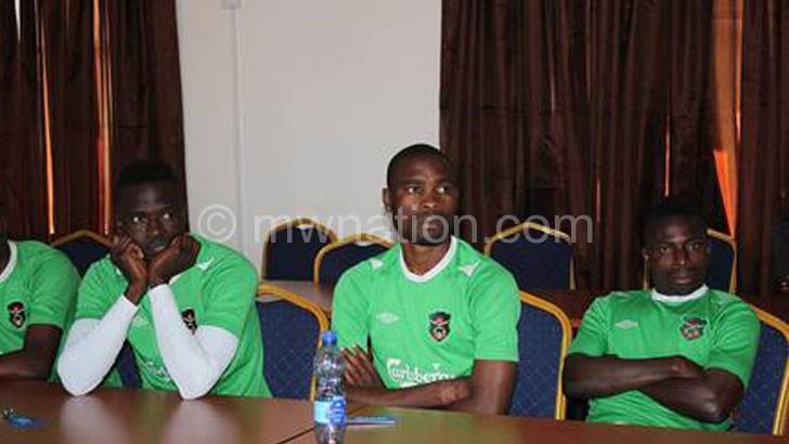 Flames captain Mzava (L) and midfielders Robert Ng'ambi  (C) and John CJ Banda