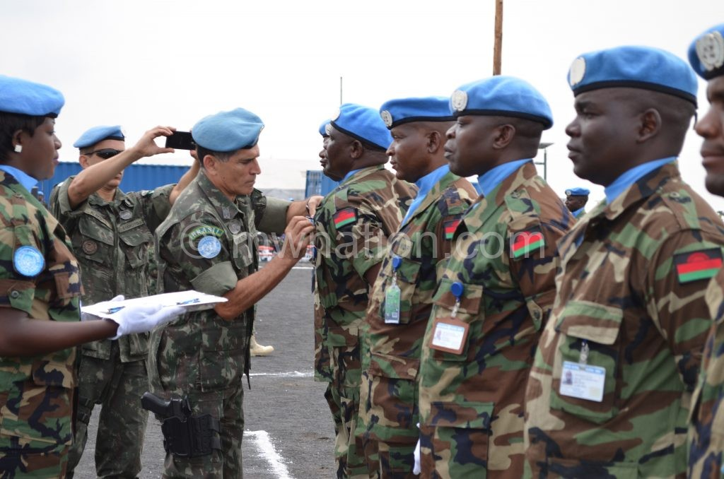 MDF soldiers being decorated during a peace-keeping mission in DRC