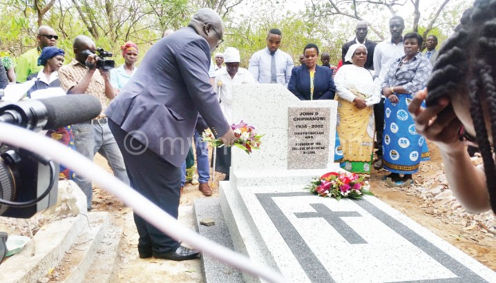 Malunga lays a wreath during the memorial
