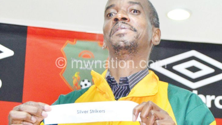 Sulom fixtures secretary Patrick Chisale draws Silver Strikers during the draw