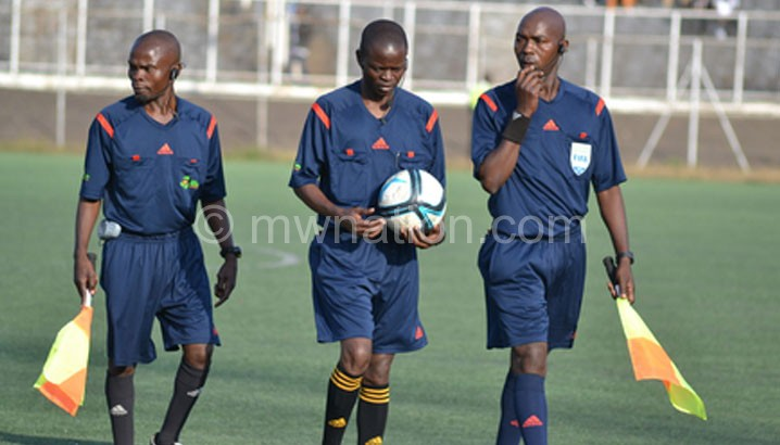 Referees getting ready to officiate a Super League match