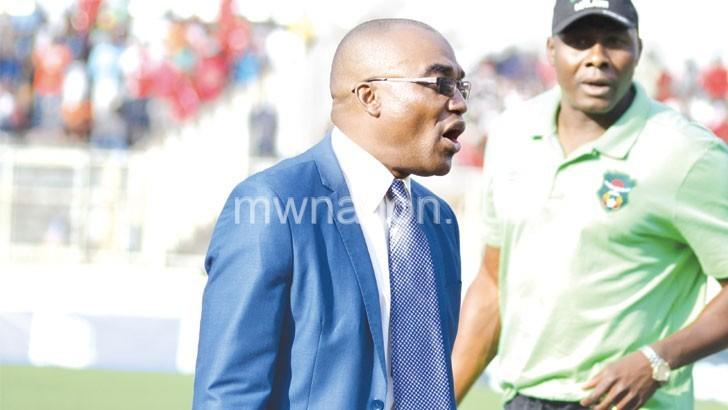 Caretaker coach Ramadhan (L) leading the Flames against Swaziland