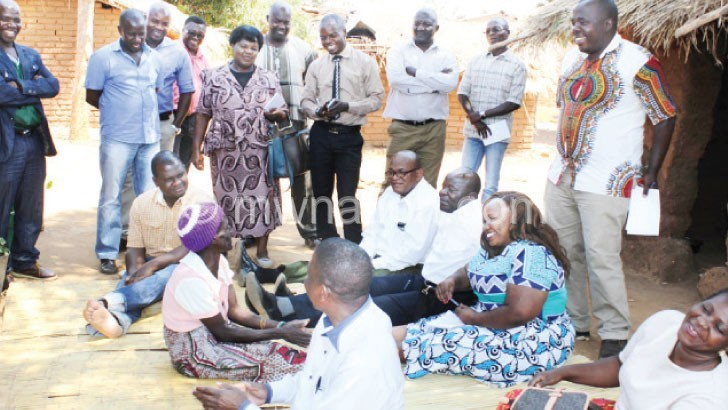 Parliamentary Committee on Social and Community Affairs members interact with a SCTP beneficiary Litiness Levison in Mchinji