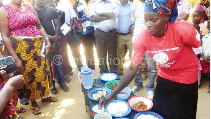 Zedi explaining to the visitors how to prepare nutritious food