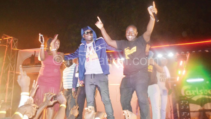 Busy Signal (C) dances to one of his songs played at the concert
