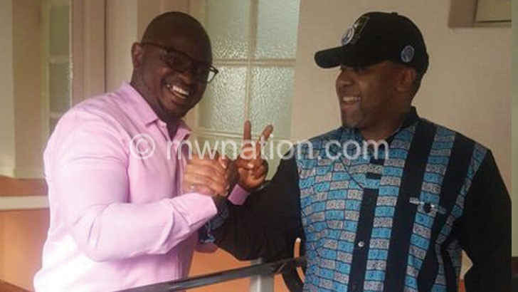 Chilima shares a lighter moment with Ulaya after accepting the request