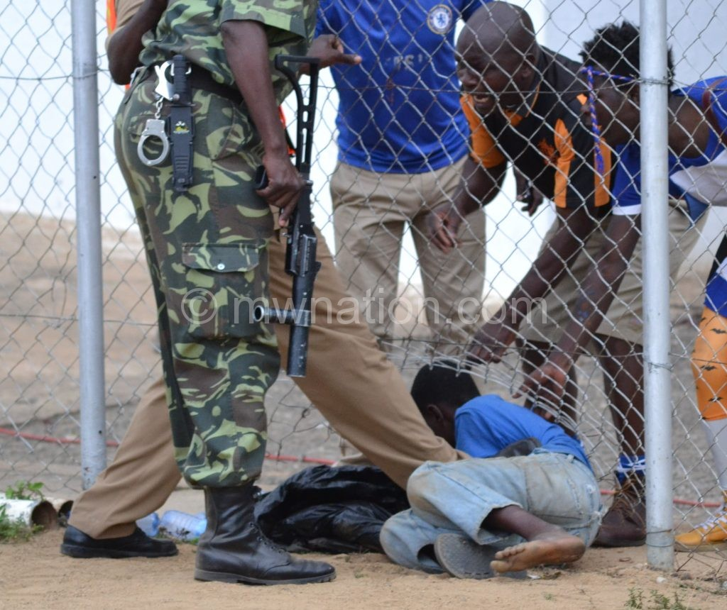 Police officers captured beating up a football supporter