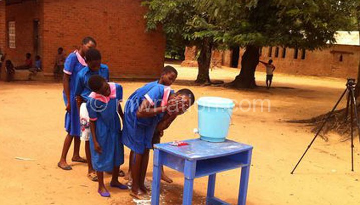 Learners at Nsalabani Primary School demonstrating how they wash their faces
