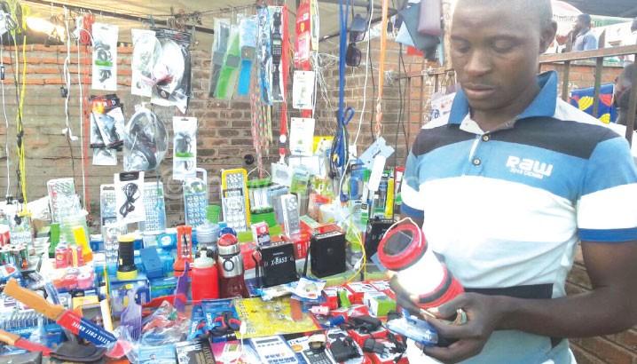 Making a killing: A vendor sells a solar lamp