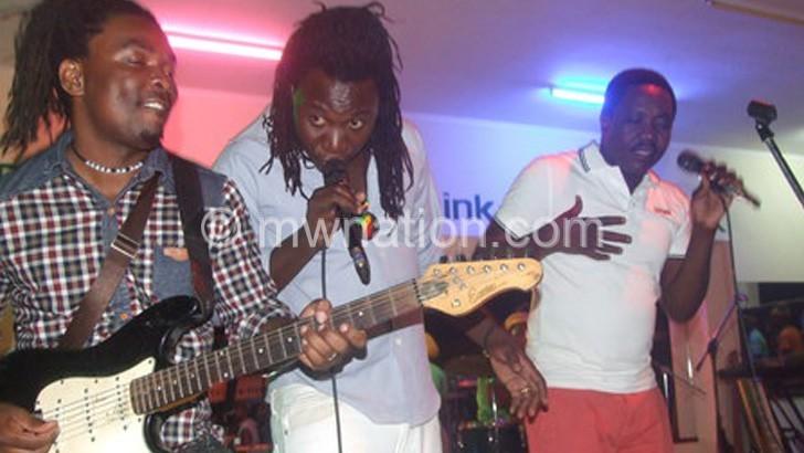 Taku (L) and Blacks' Chizondi (C) and Anjiru performing together