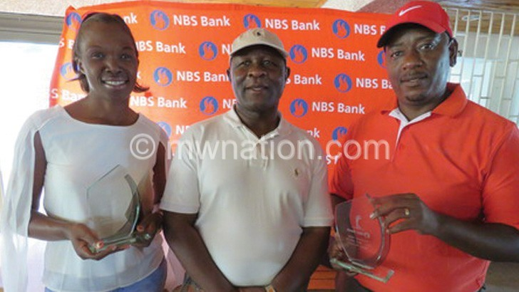Mandala (R) and Kamphulusa (L) sandwich Chigoga after receiving their trophies