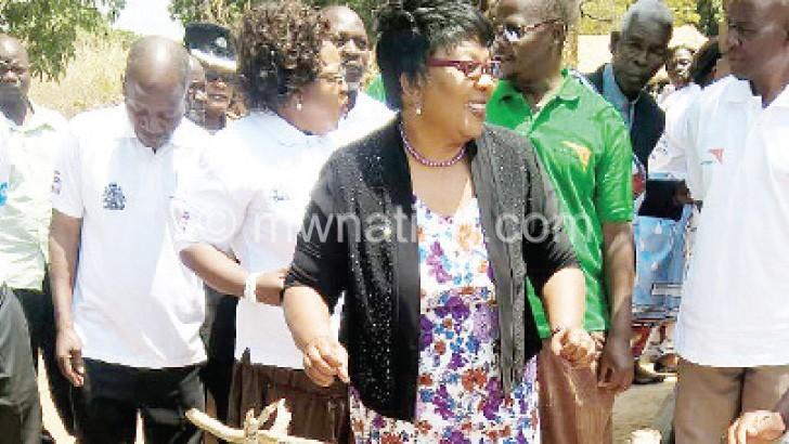 Banda admires home-made washing tool