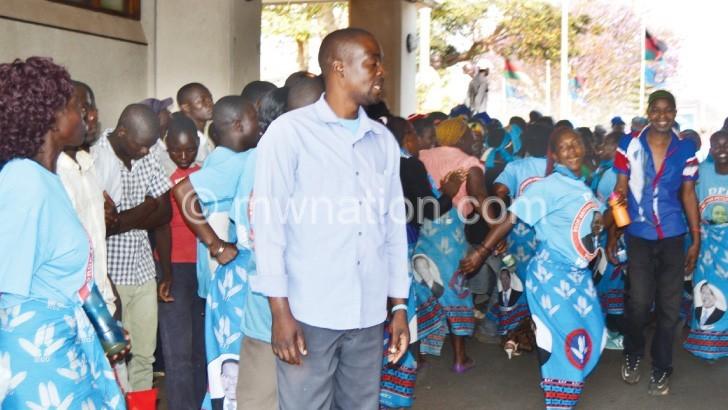 Anxious moment: DPP supporters await Mutharika's arrival at Kamuzu International Airport yesterday