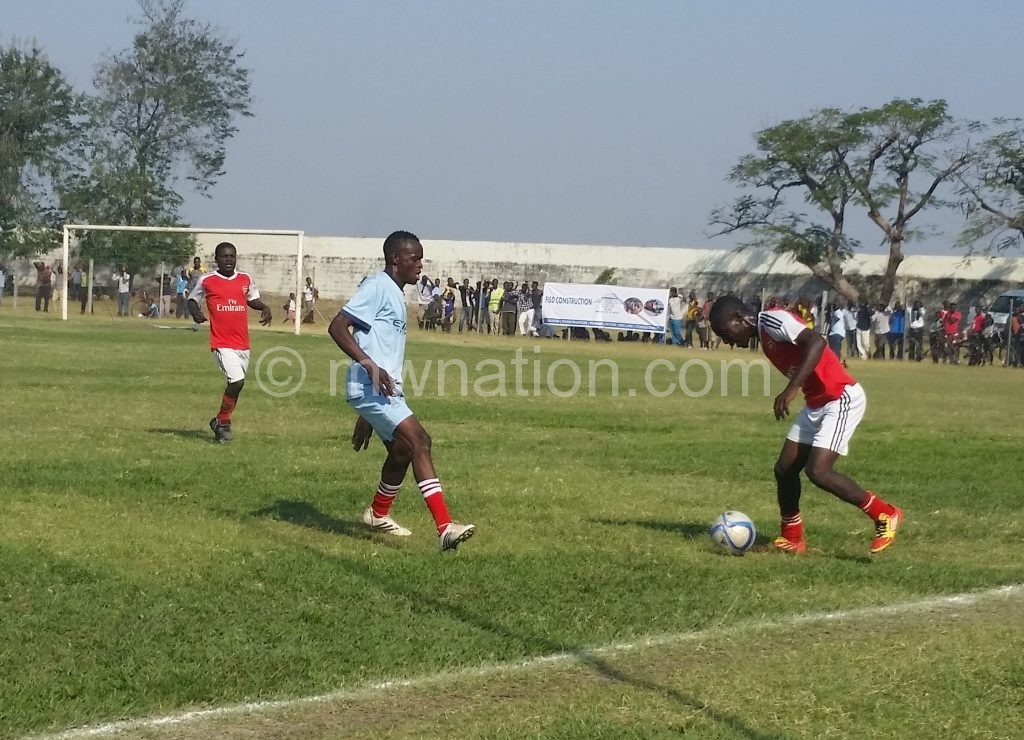 Dululu (in blue) in action against Mwanza Madrid in the  early stages of the competition