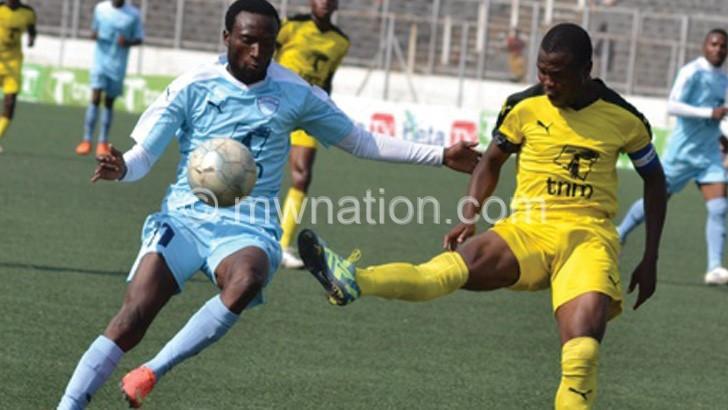 Scorer of Silvers goal Kumwenda (L) tries to  beat a Tigers defender