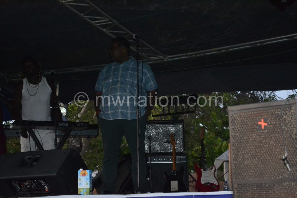 Lucius Banda waits on stage for power to be back for him to perform