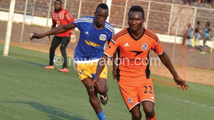 Nomads two-goal hero Ngambi (R) takes the action into Karongas half