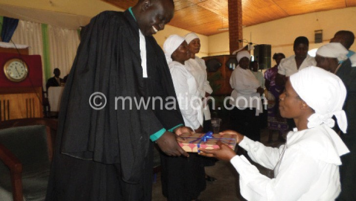 Rev Khuzeya receives a present from member of  the women's guild at the church