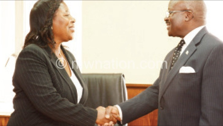 Justice Nyirenda congratulates Ansah after she was sworn in yesterday