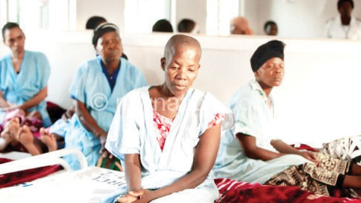 Women captured during breast cancer treatment at an African hospital
