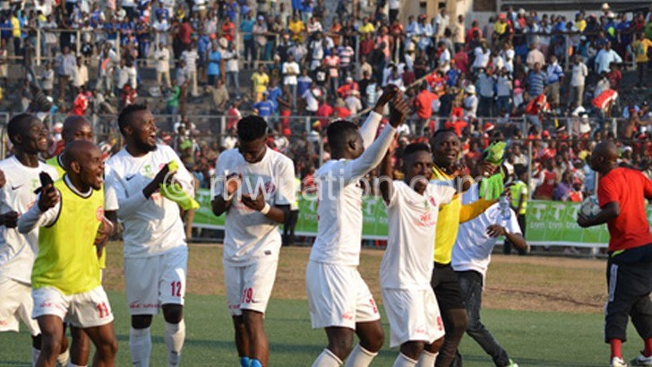 Bullets players celebrate after beating Wanderers