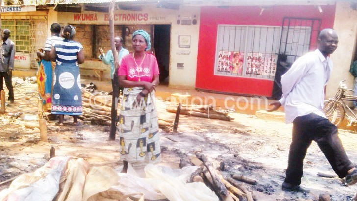 Traders at the burnt market