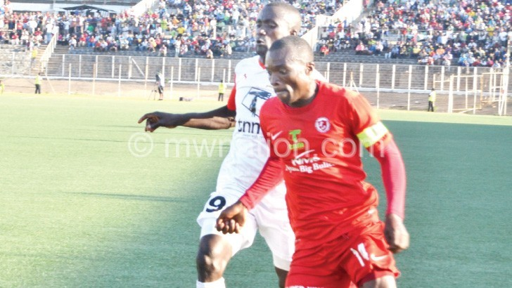 Six-goal thriller: Bullets' Chiukepo Msowoya (R) tries to beat Red Lion's Loti Mwakisulu during the match