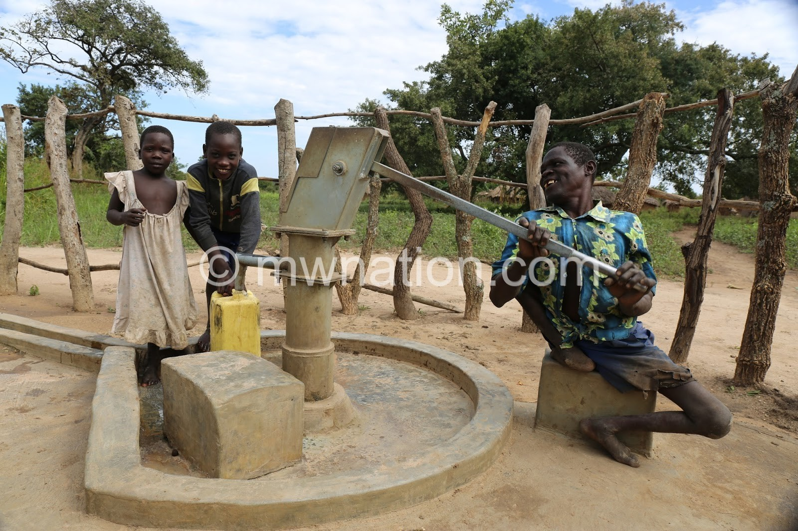 A man with a disability pushing a borehole