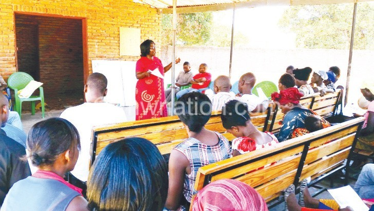 Dzimadzi (standing) addresses the youths
