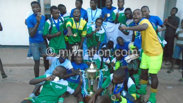 Silver Youth celebrate with their trophy