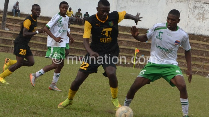 Wizards (in white)  are out of the relegation zone after beating Kamuzu Barracks