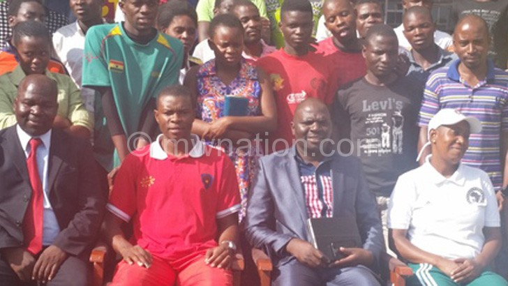 Chisi (seated 2ndR)) and Sangala (seated 2ndL) pose with  participants and officials