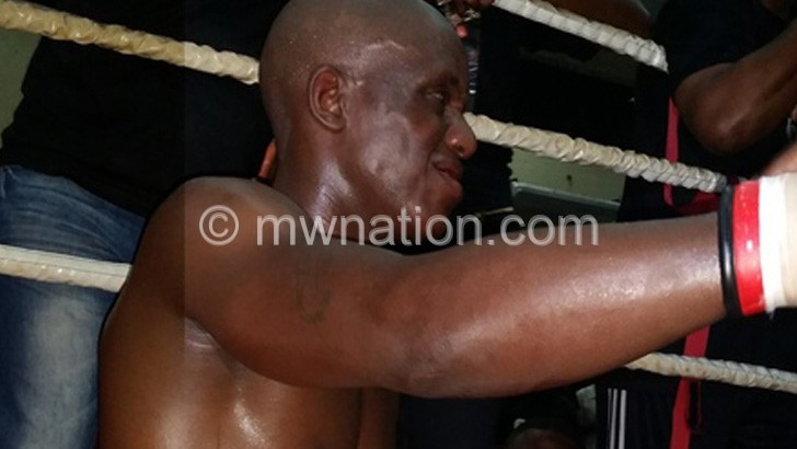 Mwando grimaces following Makawa's  continuous throw of punches