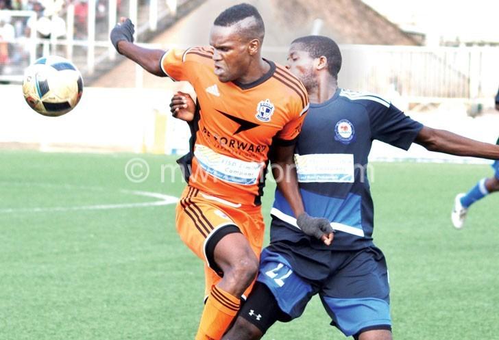 Under arrest: Wanderers striker (L) tightly marked by Gio Banda