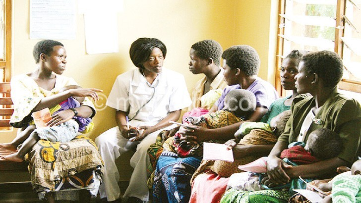 A nurse counsels mothers during a family planning session