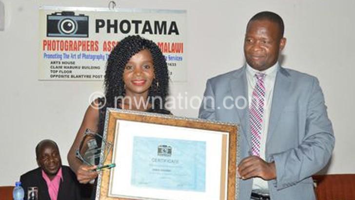 Chikondi gets her award from Ndipo