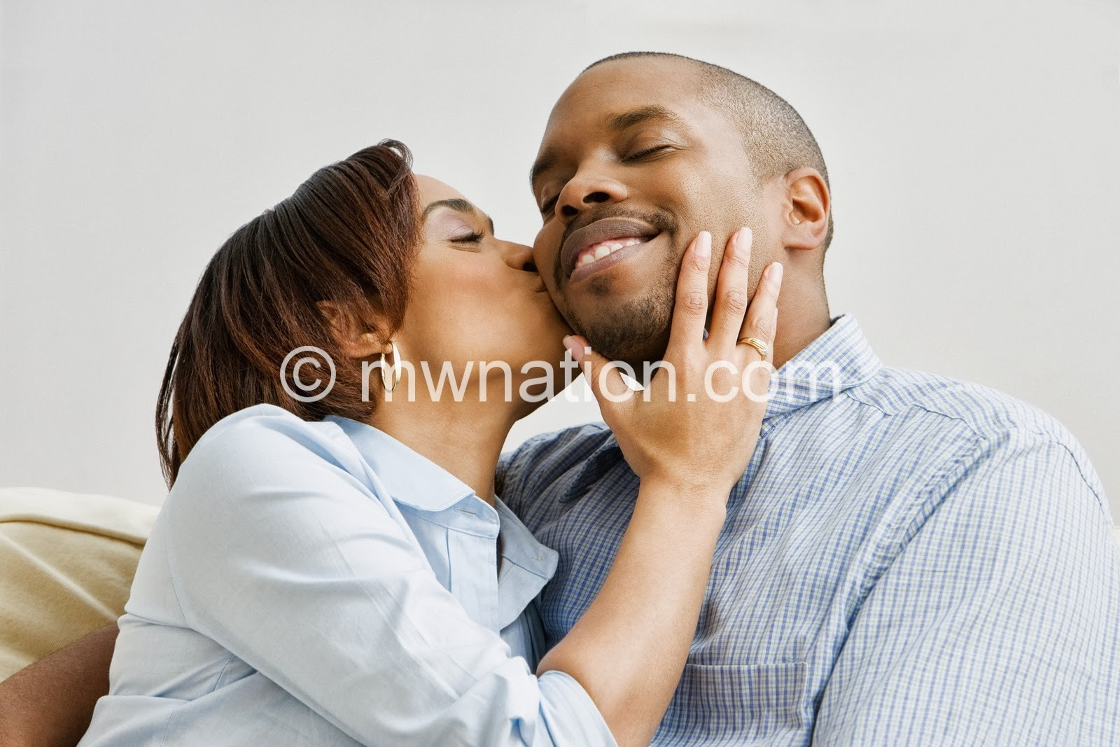 African American Couple Kissing | The Nation Online