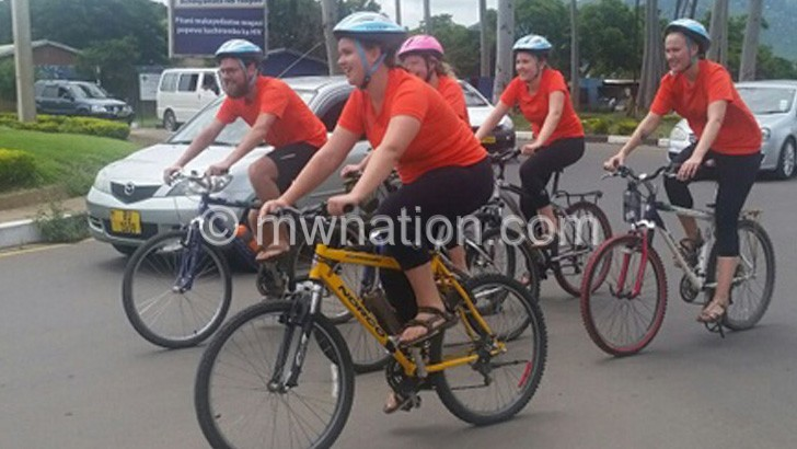 Danish students cycle  for poor Malawians