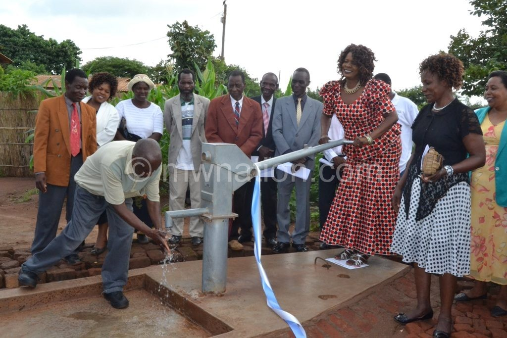 Bondo pumping water from one of the boreholes | The Nation Online