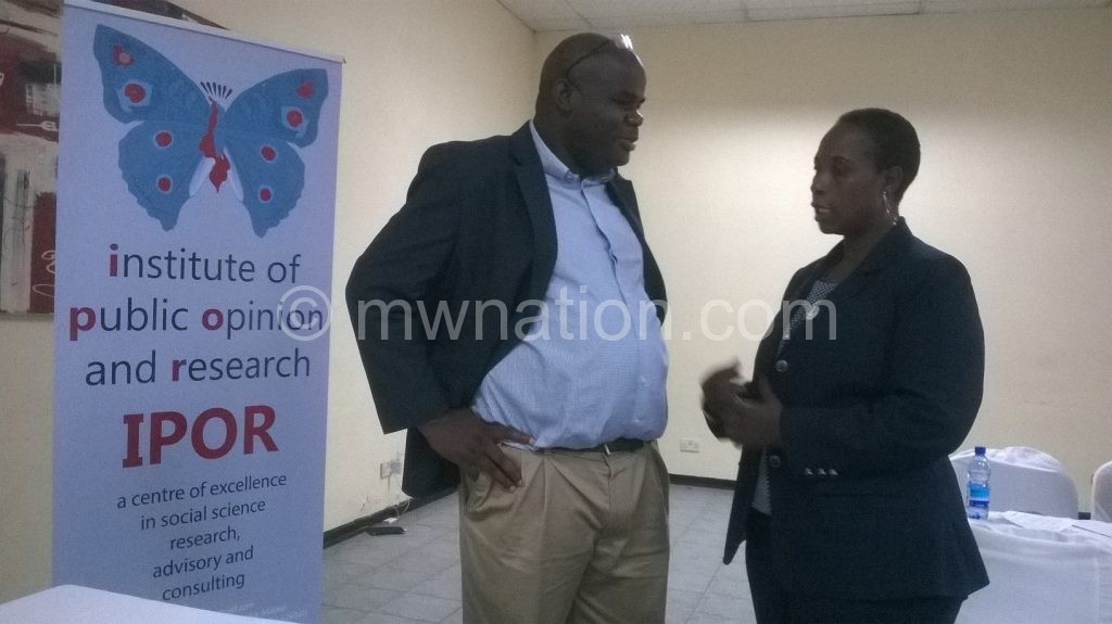 Dulani and Kabwila sharing notes after the dissemination of the study | The Nation Online