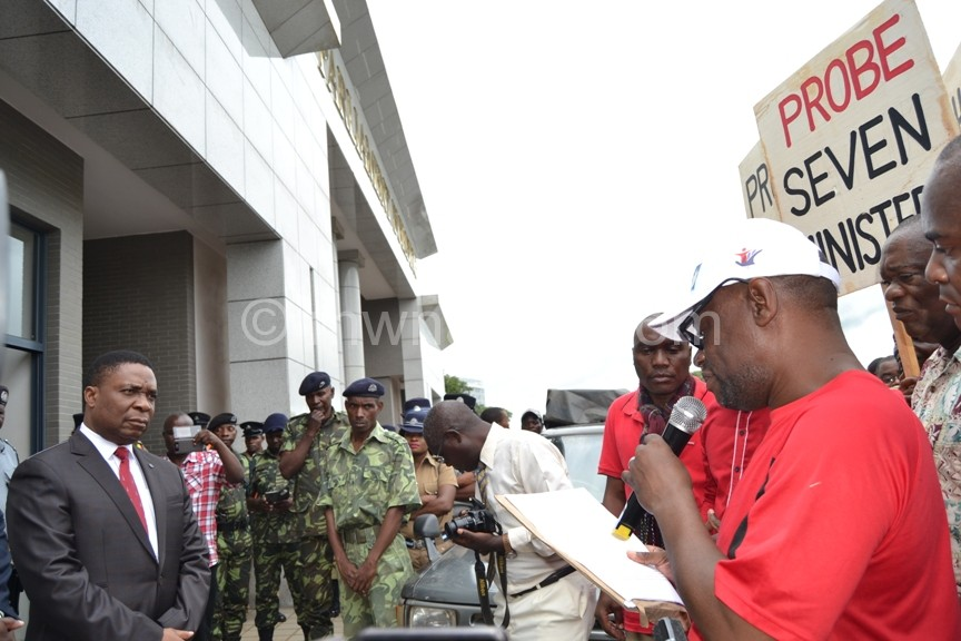 CSOs chairman Billy Mayaya reads a petition before he delivers to Hon. Kamlepo Kalua c Abel Ikiloni Mana | The Nation Online