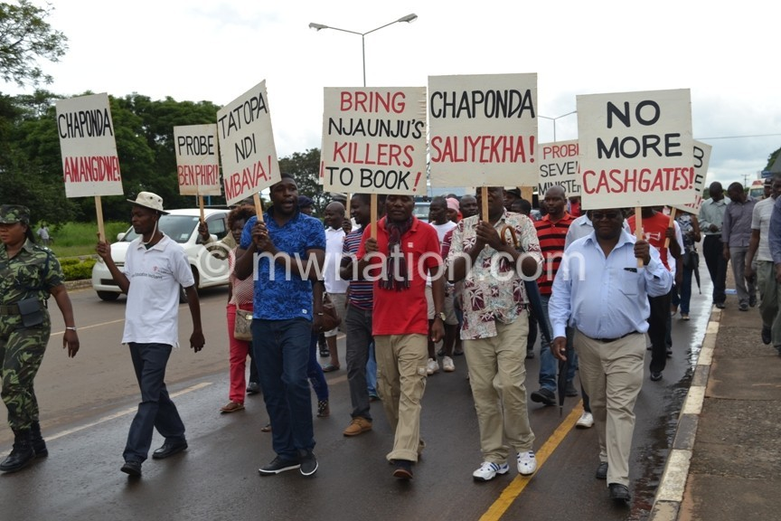 Civil Society Organizations demonstrate their anger by carrying placards to Parliament in Lilongwe c Abel Ikiloni Mana 2 | The Nation Online