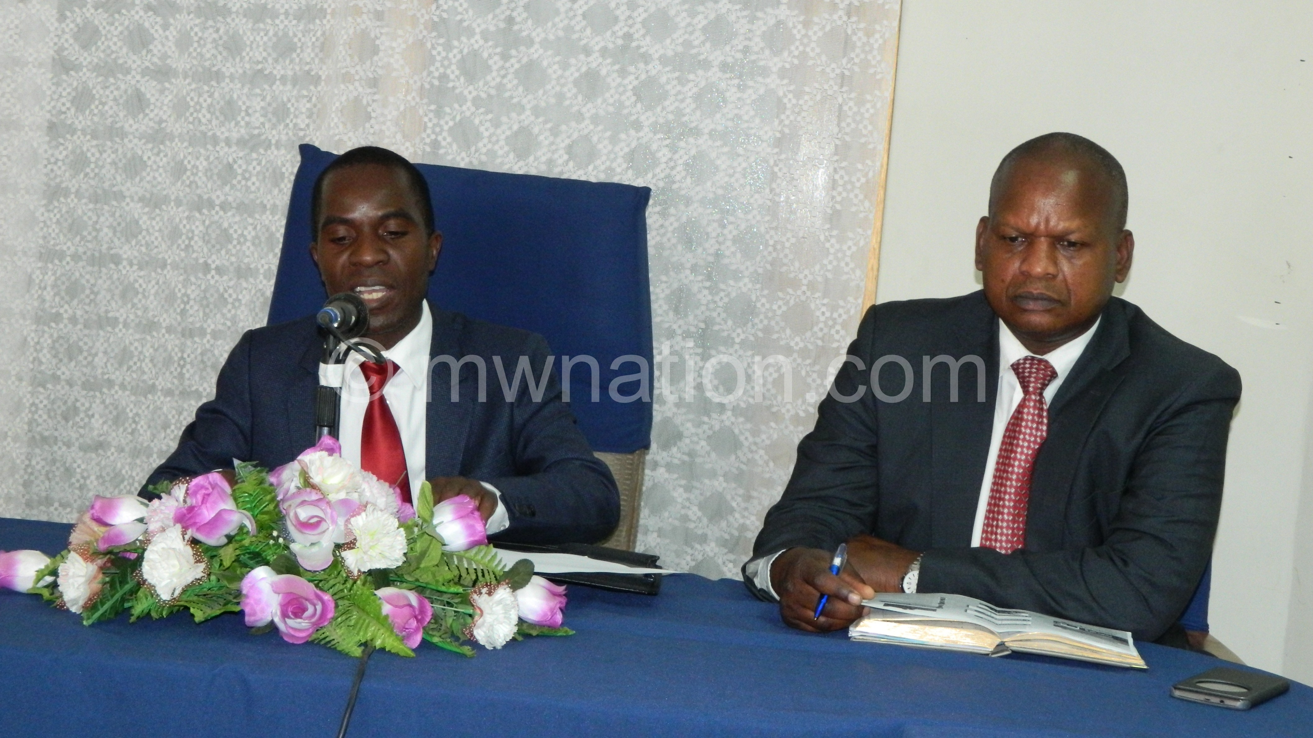 Chiunda left speaking during the media briefing while Mutala Phiri looks on | The Nation Online