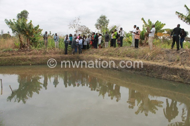 Journalists visit a fish pond. | The Nation Online