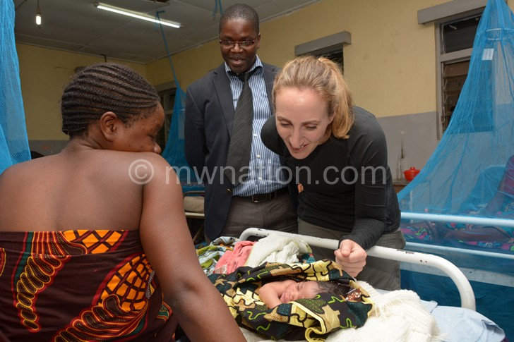 British High Commissioner Holly Tett admires a baby 3 | The Nation Online