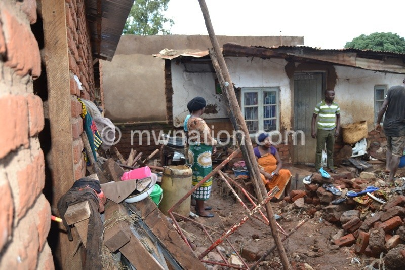 Disaster Veep 1 Counting the cost. a Family in Kawale look dejected as their property was washed away. Photo by Fatsani Gunya   The Nation Online