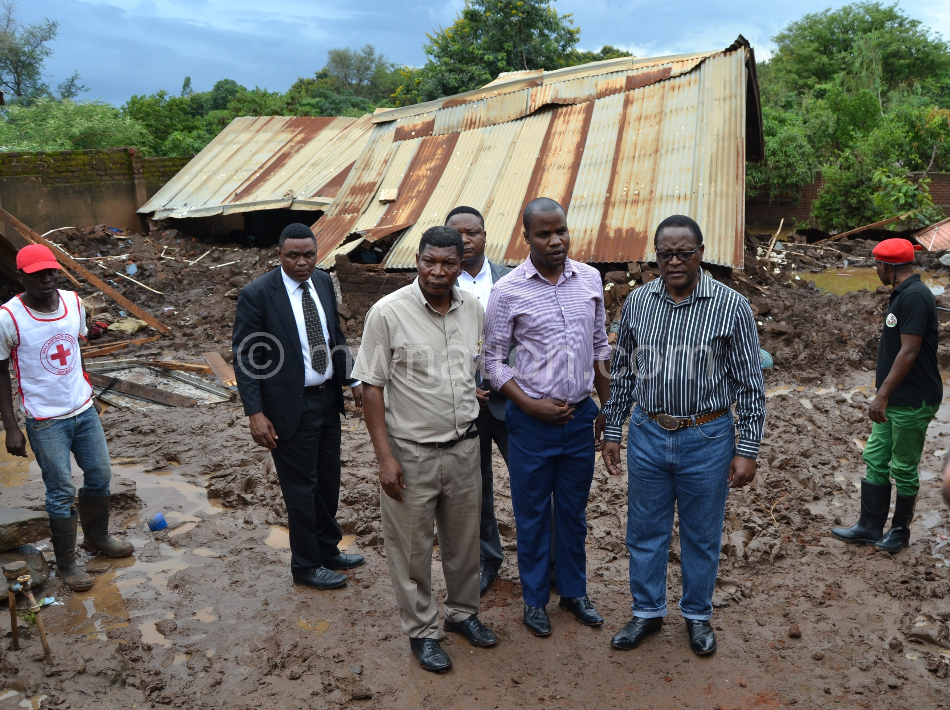 MCP President Lazarus Chakwera appreciates the damage caused to one of the affected households. Photo by Fatsani Gunya | The Nation Online